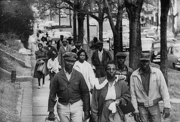 Thousands of black commuters are shown walking long distances to work instead of riding the buses during the Montgomery bus boycott, 1956.
