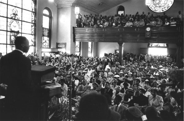 Martin Luther King, Jr. speaking in church during the Montgomery bus boycott.