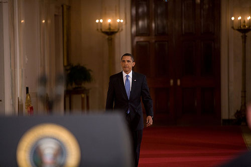 President Barack Obama walking to a prime time press conference.