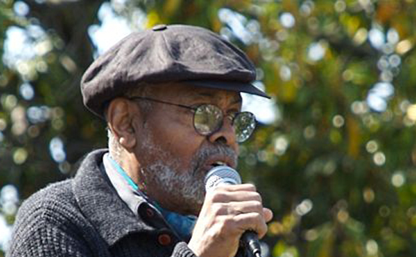 Amiri Baraka addressing the Malcom X Festival in San Antonio Park, Oakland, California.