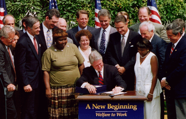 President Clinton signs the 1996 PRWORA legislation.