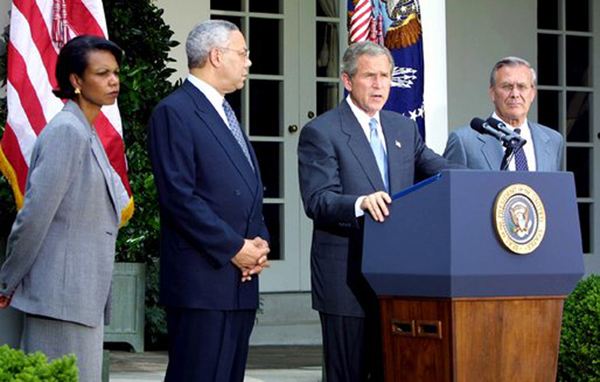 U.S. President George W. Bush (at podium) in the White House Rose Garden on June 24, 2002.